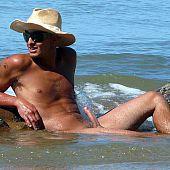 Nudist fully exposed beach.
