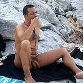 Stripped guys on the nudist beach.